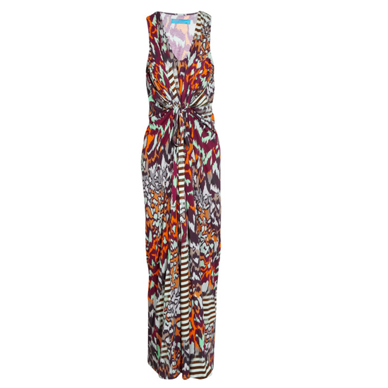 >> A tribal print gets grounded by  strappy black flats. Braided bracelets and a long-strapped pouch add a downtown vibe. Matthew Williamson Printed Maxi Dress , $675 Looks chic with: