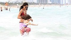 Video: Bikini-Clad Katie Holmes Hits the Beach With Suri!