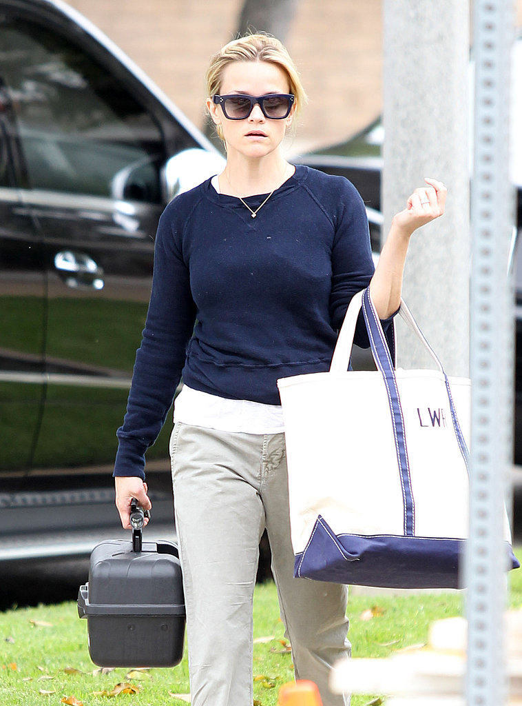 Reese Witherspoon had her hands full with a bag and a box.