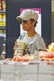 Halle Berry grabbed a stack of fruit.
