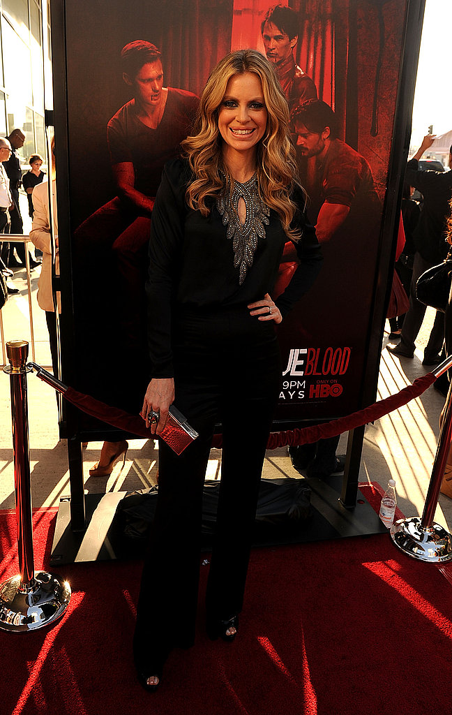 Kristin Bauer struck a pose in front of a True Blood poster.