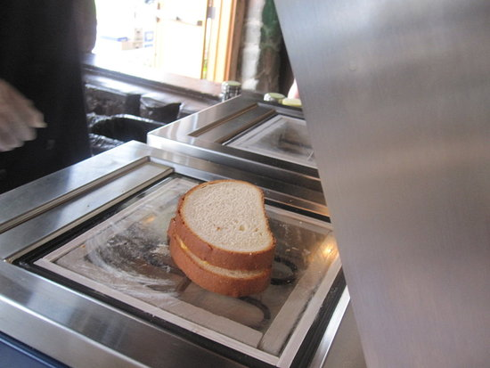 The grilled cheese machine simultaneously microwaves and toasts the sandwich.