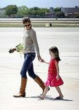 Katie Holmes held Suri's hand at a Miami Airport.