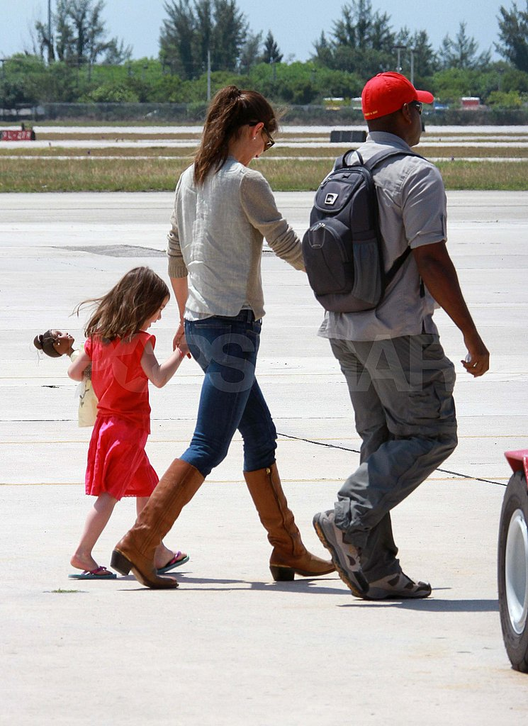 Katie Holmes held Suri's hand at an airport in Miami.