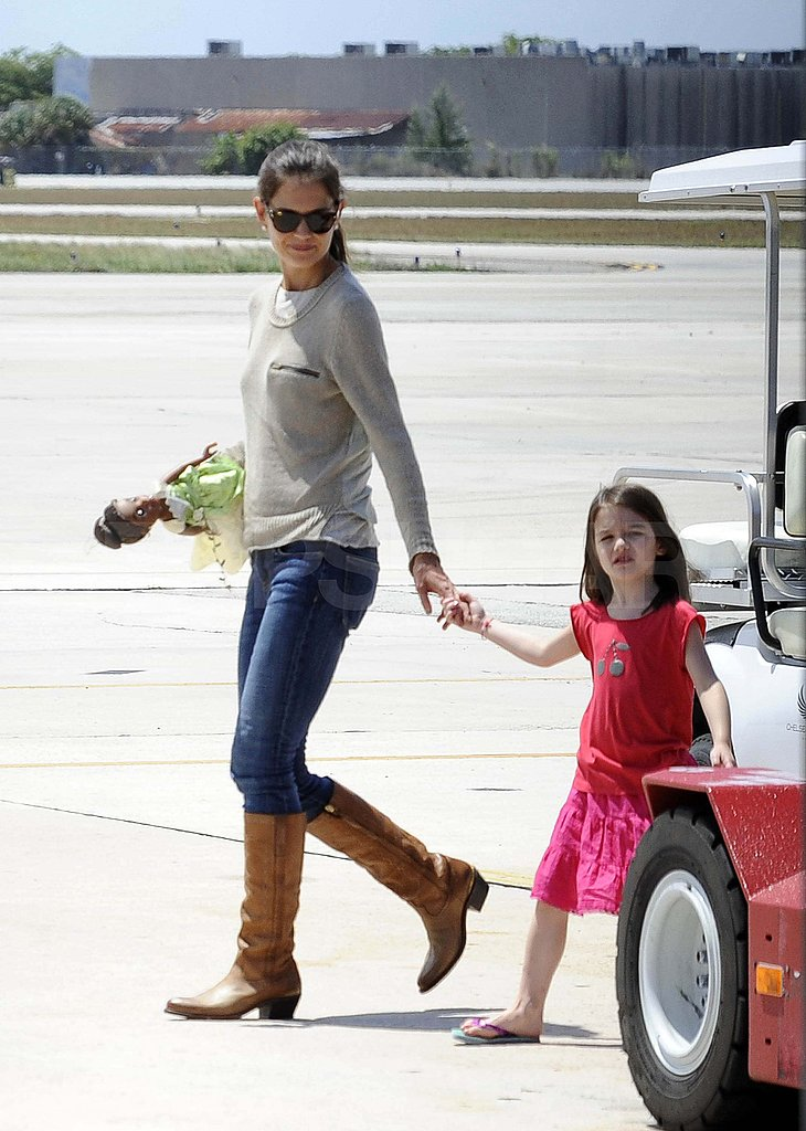 Katie Holmes and Suri walked together at a Miami airport.