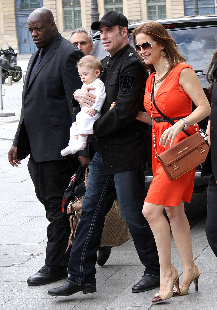 Kelly Preston walks with son Benjamin Travolta and husband John.