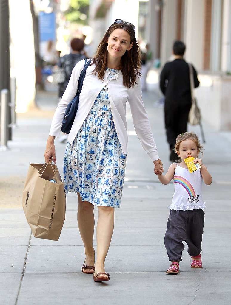 Seraphina Affleck sipped a juice pack while Jennifer Garner toted a shopping bag.