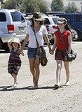 Rachel Bilson held hands with her sisters Hattie and Rosemary.