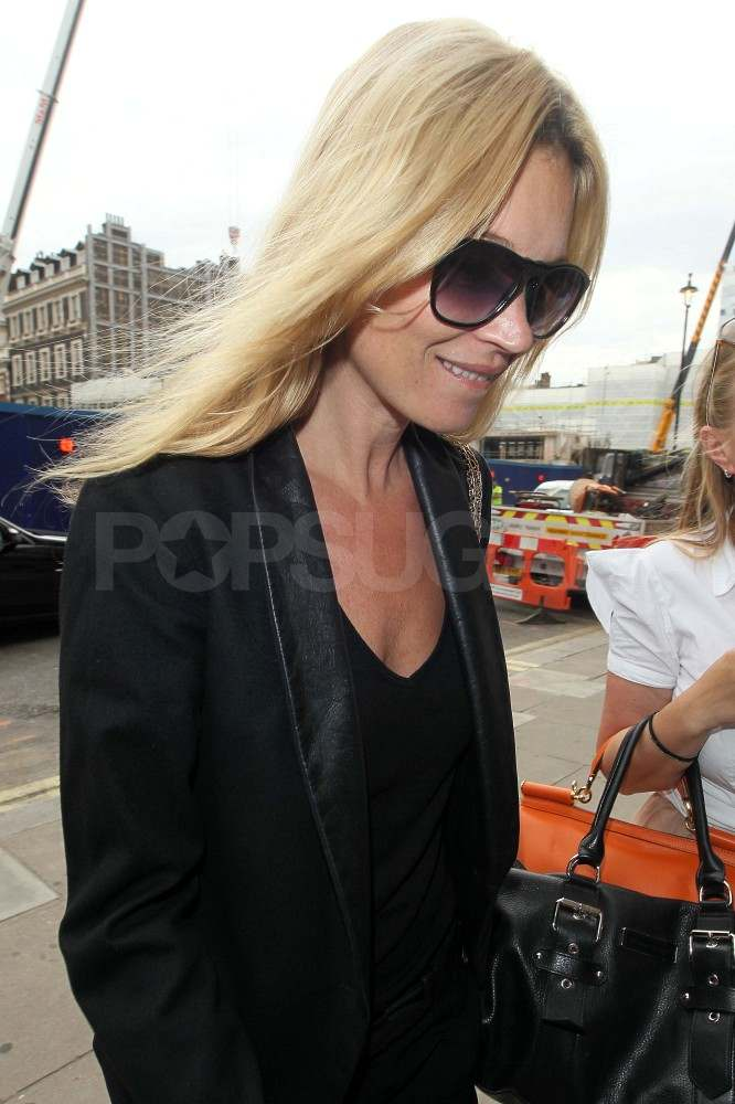 Kate Moss smiled in London.