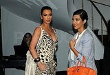 Kourtney Kardashian carried an orange Birkin bag.