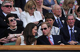 Prince William and Kate Middleton chat tennis.