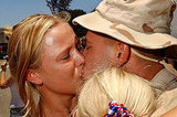 Tara Johnson sheds a tear as she kisses her husband, Staff Sgt. Nathan Johnson, upon his return from Iraq on July 2, 2003, at Camp Pendleton, CA. Just in time for the Fourth of July!