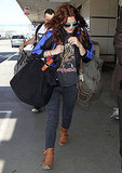 Drew Barrymore dressed casually for her departing flight out of LAX.
