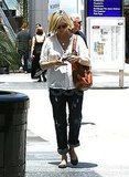 Pregnant January Jones checked out her phone in LA.