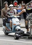 Anna Faris and Sacha Baron Cohen were towed along behind a camera on their Vespa.