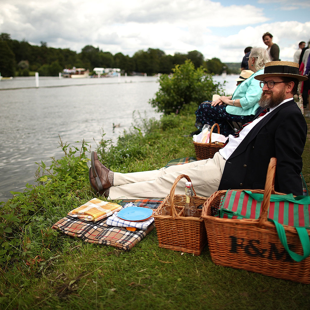 A man sits on the riverside to watch the races.