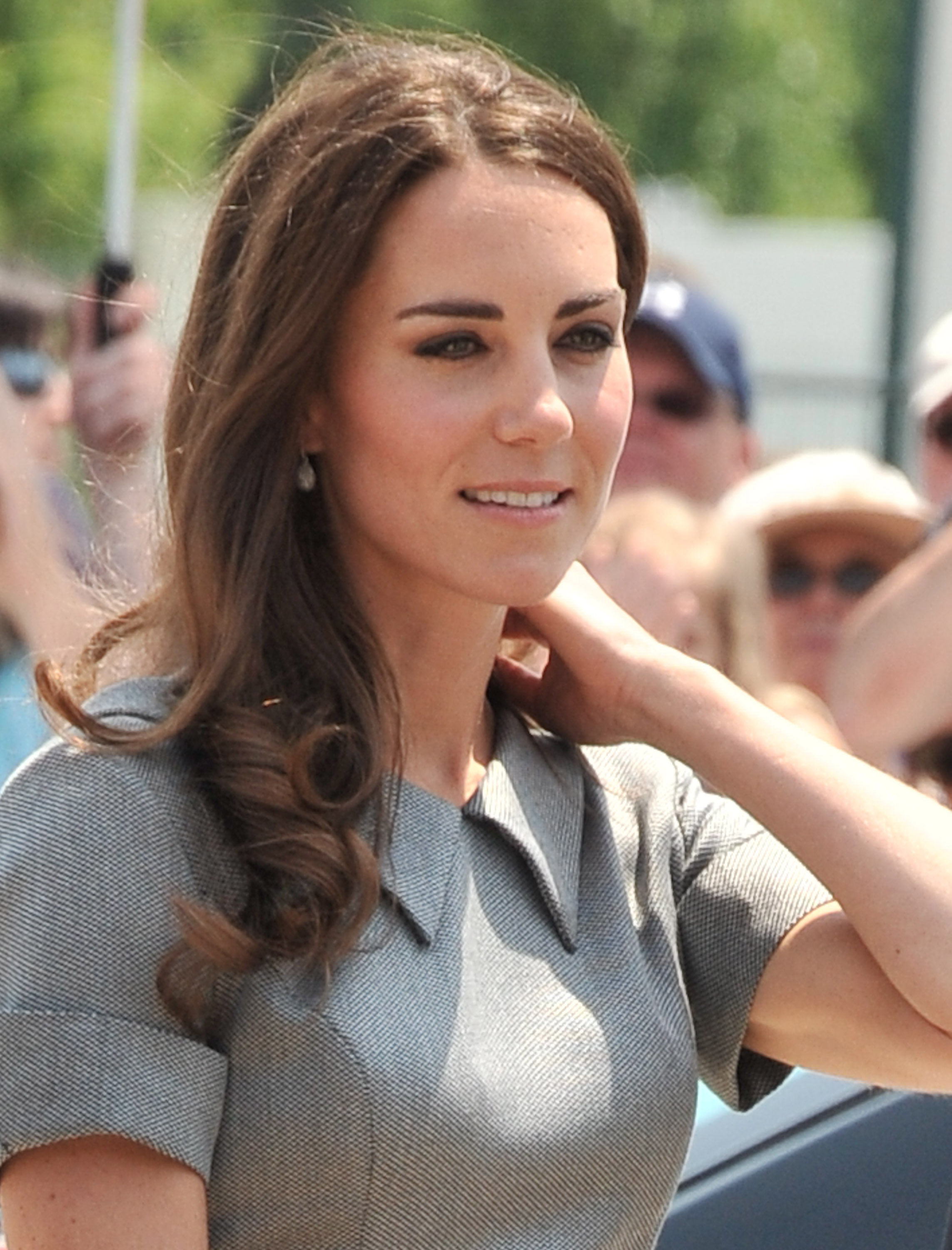 "July 2nd, 2011 Attending a tree planting ceremony in Ottawa, Canada.   Kate wears a grey Catherine Walker ""Kensington"" dress and Links of London Hope Egg earrings."