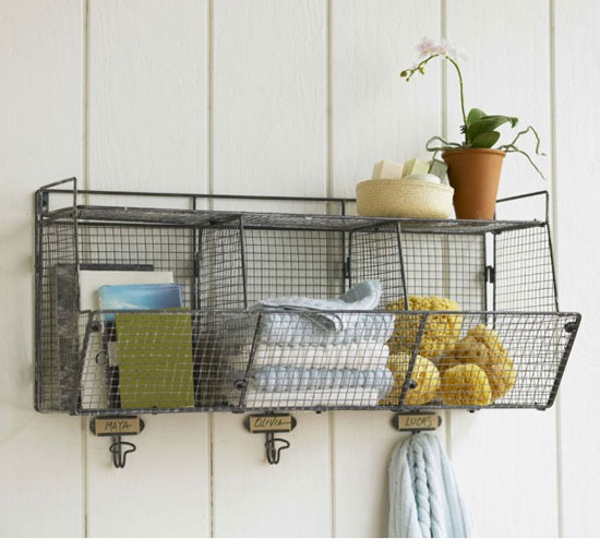 This Three-Bin Wire Shelf ($170) is simple, but it's a great option. Write someone's name, or each shelf's purpose, above each hook to keep things separate.