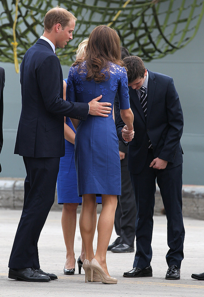 Prince William touches Kate's back as they arrive in Quebec City.
