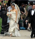 Mila Kunis carried a bouquet of fresh flowers.