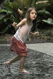 Suri Cruise stepped out into the storm.