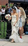 Mila Kunis hiked up her wedding gown.