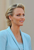 Princess Charlene of Monaco smiles in her baby blue Chanel frock.