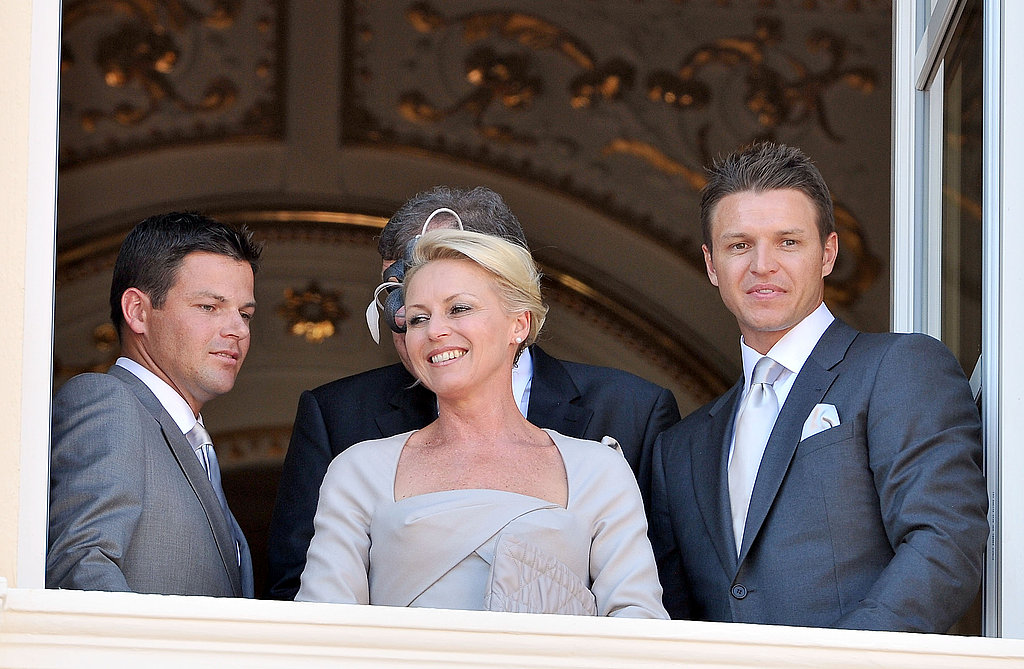 Princess Charlene of Monaco's family Sean Wittstock, Lynette Wittstock, and Gareth Wittstock look out at the crowd.