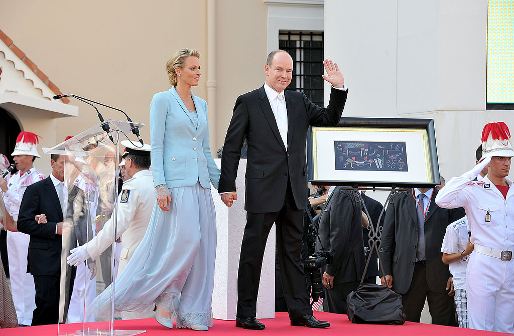 Princess Charlene of Monaco is hand in hand with Prince Albert II of Monaco.