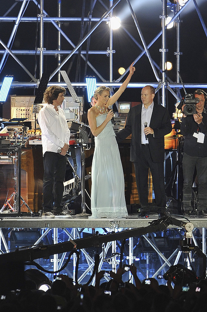 Princess Charlene of Monaco and Prince Albert II of Monaco join French artist Jean Michel Jarre on the stage at his sound and music show.