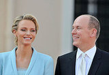 Princess Charlene of Monaco laughs with Prince Albert II of Monaco.