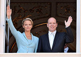 Princess Charlene of Monaco and Prince Albert II of Monaco wave after the ceremony.