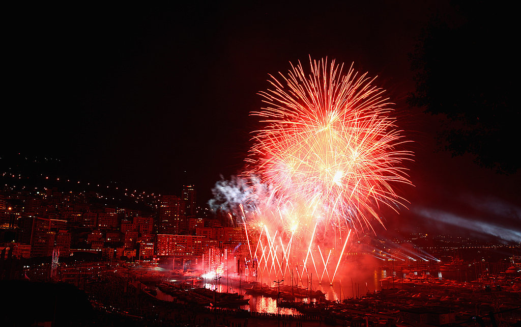 Red fireworks explode at the concert for Princess Charlene of Monaco and Prince Albert II of Monaco.
