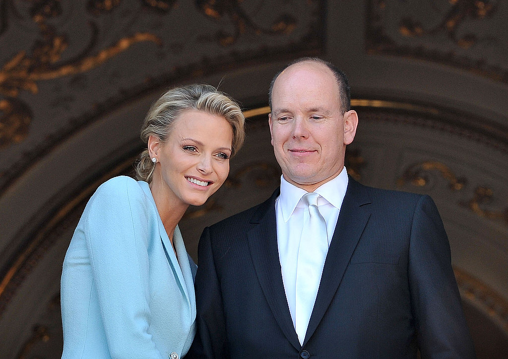 Princess Charlene of Monaco gets close to Prince Albert II of Monaco.