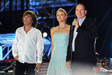 Princess Charlene of Monaco and Prince Albert II of Monaco join French artist Jean Michel Jarre.