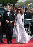 July 9th, 2011 Arriving with Prince William to the BAFTA Brits to Watch event at the Belasco Theatre in Los Angeles, California.   Kate wears a floor-length, softly pleated lilac chiffon gown by Alexander McQueen, Jimmy Choo Vamp sandals, a Jimmy Choo Ubai clutch, and chandelier earrings on loan from the Queen.