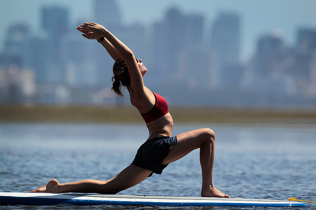 A yoga instructor poses during her paddleboard yoga session in Miami.
