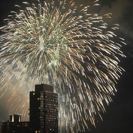 Fourth of July fireworks explode over New York City.