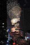 Crowds watch the Macy's fireworks show in New York City.