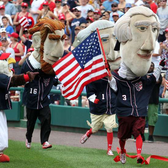 US president mascots at the Washington Nationals and Chicago Cubs game run through the field.