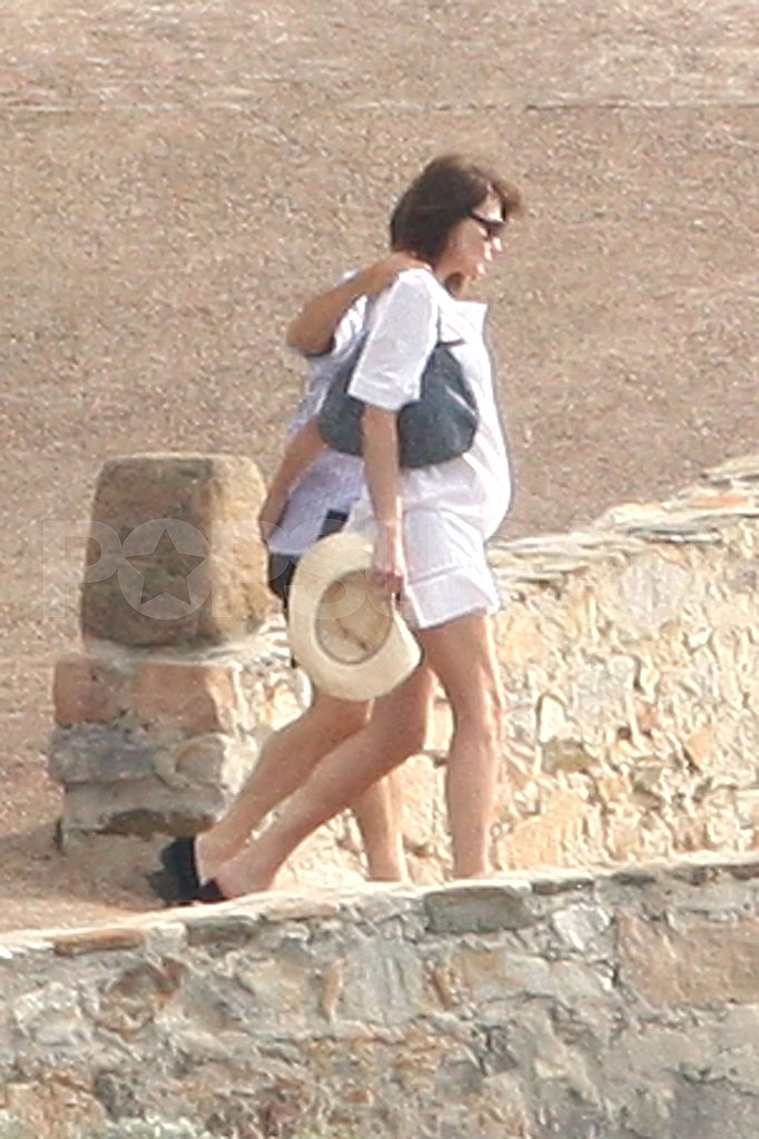 Carla Bruni-Sarkozy and Nicolas Sarkozy head out for a swim.