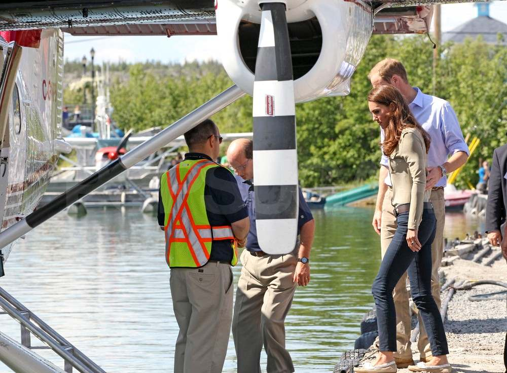 Kate Middleton and Prince William board a seaplane in Canada.