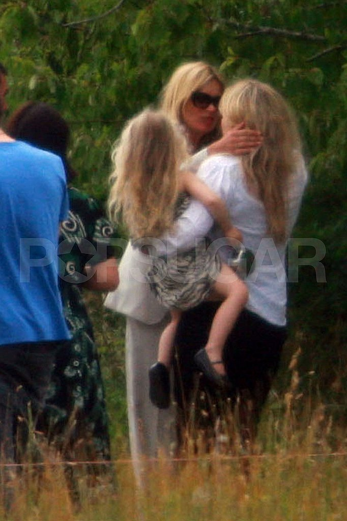Kate Moss kisses friends goodbye.
