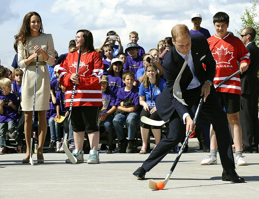 Kate Middleton watches husband Prince William play hockey.