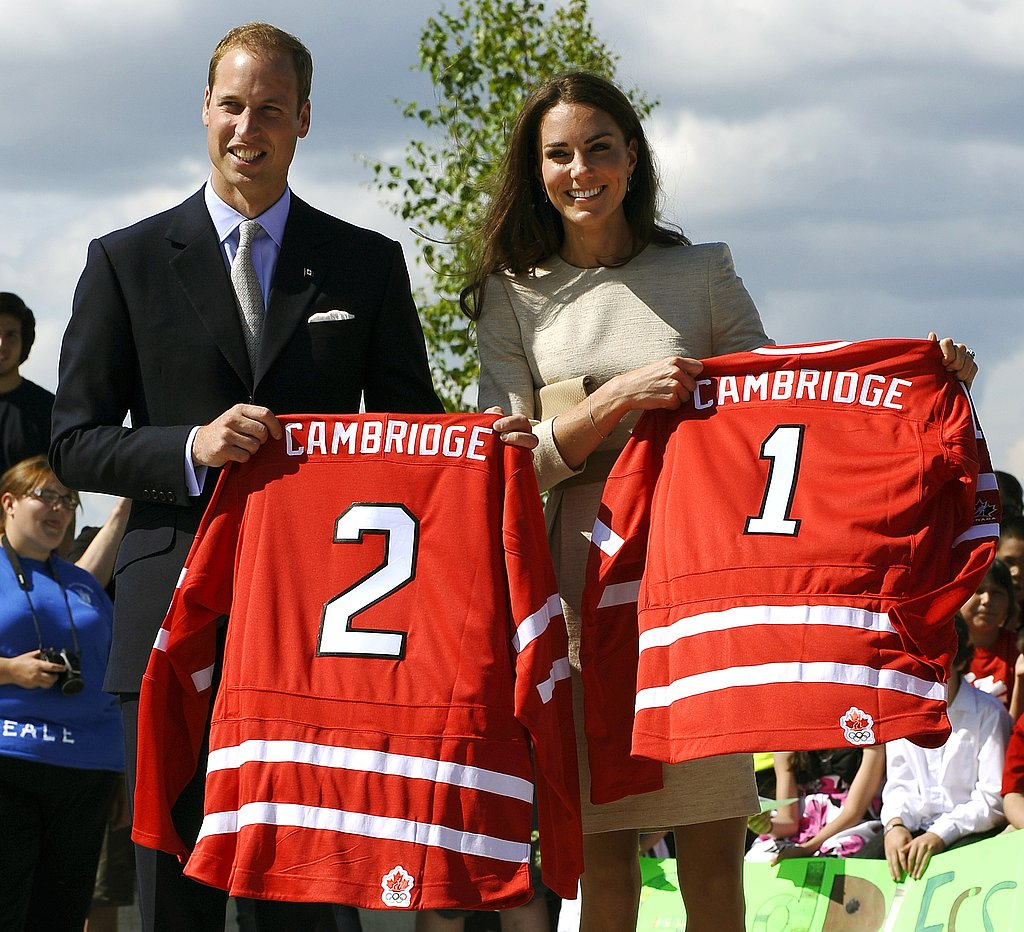 Kate Middleton and Prince William hold hockey jerseys on their Canadian tour.