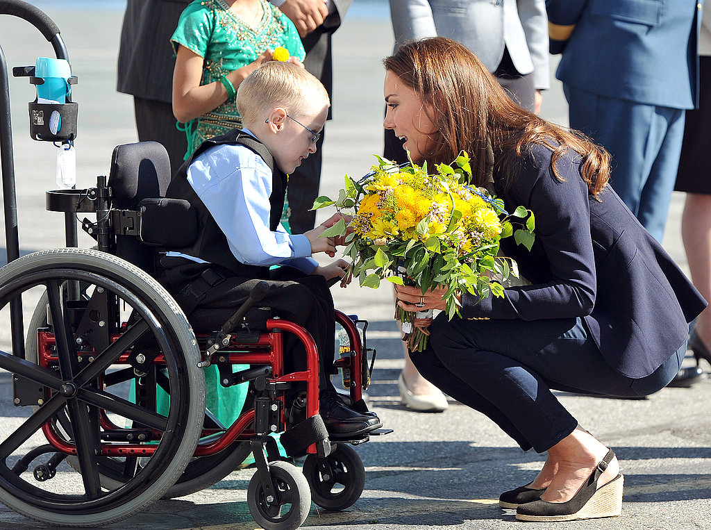 Kate Middleton greets a child in Canada.