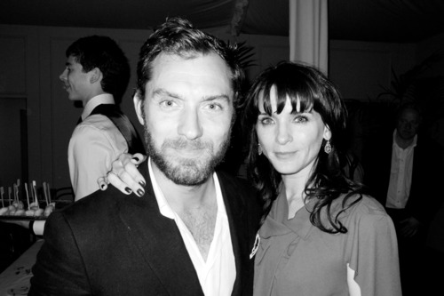 Jude Law posed with Michelle Hicks at Kate Moss and Jamie Hince's wedding.