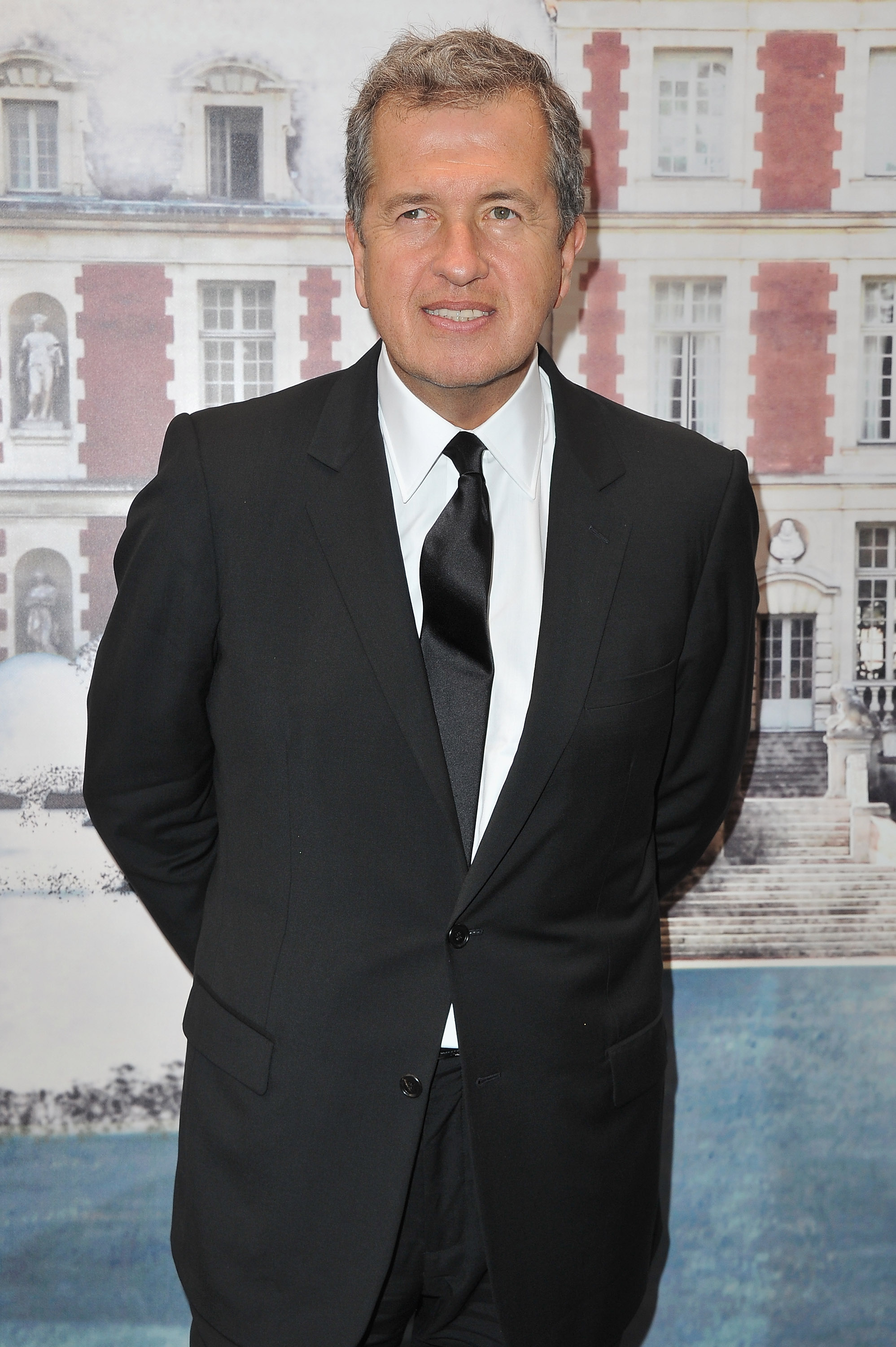 Photographer Mario Testino looked handsome in a tux.