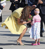 Kate Middleton accepted a bouquet of flowers.