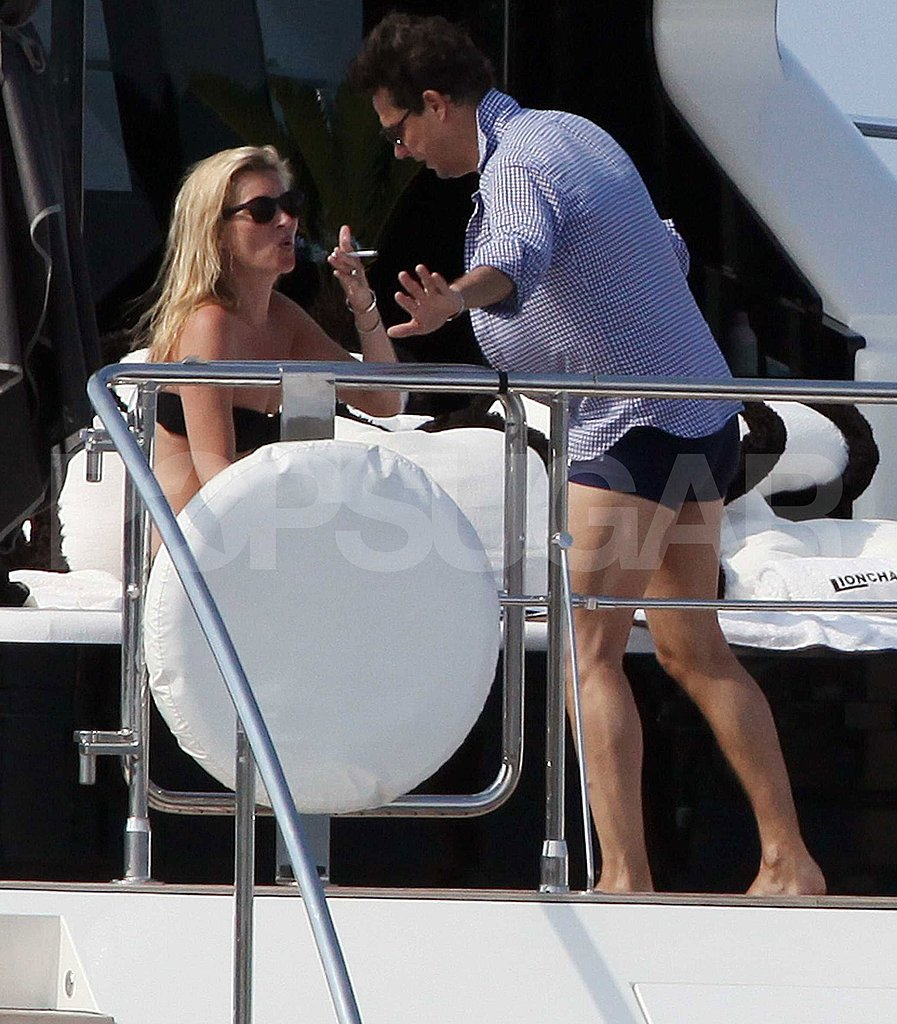 Kate Moss took a smoke break as she relaxed with Jamie Hince.